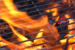 BBQ Charcoal Flames. Just lighting the barbecue and the flames are coming up through the grill Stock Photo