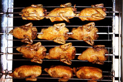 BBQ Chicken. Delicious rotisserie chicken turning on a spit Royalty Free Stock Photos