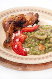 BBQ CHICKEN DRUMSTICKS YOUNG PEAS POTATO SALAD Stock Photo