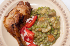 BBQ CHICKEN DRUMSTICKS YOUNG PEAS POTATO SALAD Stock Image
