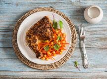 BBQ chicken and fresh carrots chickpea salad Stock Image