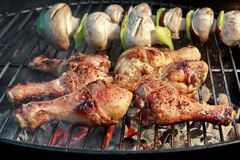 BBQ Chicken Legs And Mushrooms On The Hot Charcoal Grill Royalty Free Stock Images