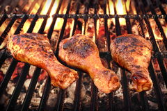 BBQ Chicken Legs Roasted On Hot Charcoal Grill. BBQ Chicken Legs Roasted On The Hot Flaming Charcoal Grill, Top View Close Up Royalty Free Stock Photography