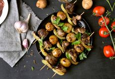 Bbq from chicken liver, potato and bell pepper. Tasty barbecue skewers. Top view Stock Images