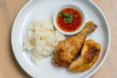 Bbq chicken. Thai style bbq chicken with sticky rice and sweet chili dipping sauce on the white plate Royalty Free Stock Photography