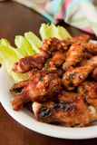 BBQ Chicken Wings. Plate of BBQ chicken wings with lettuce garnish stock images