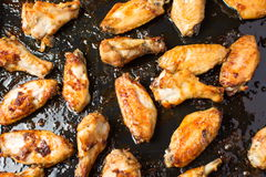 Bbq chicken wings on a black plate Royalty Free Stock Photography