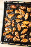 Bbq chicken wings on a black plate Royalty Free Stock Images