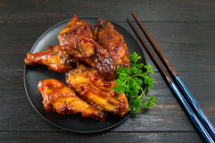 Bbq chicken wings and chopsticks Stock Photos