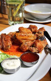 Bbq chicken wings with dips and salad Stock Images