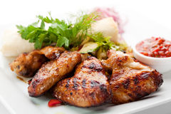 BBQ Chicken Wings. Hot Meat Dishes - Grilled Chicken Wings with Red Spicy Sauce Royalty Free Stock Photography