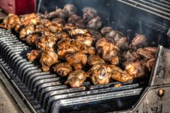 BBQ Chicken Wings on an Outdoor Grill Stock Images