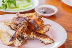A grilled chicken wing. BBQ chicken wings with sauce for dip stock image