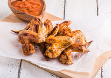 BBQ Chicken Wings with sauce Stock Images