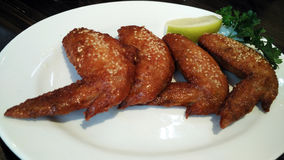 Bbq chicken wings with sesame and lemon. Oven roasted bbq chicken wings healthy baked instead of fried Royalty Free Stock Photo