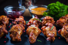 BBQ chicken wings with spices and dip Stock Image