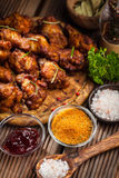 BBQ chicken wings with spices and dip Royalty Free Stock Photos