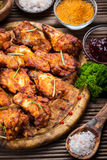 BBQ chicken wings with spices and dip Stock Photos