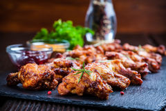 BBQ chicken wings. With spices and dips Royalty Free Stock Images