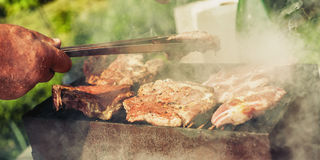 BBQ. Closeup of barbecue grilling picnic in backyard outdoor Royalty Free Stock Photography