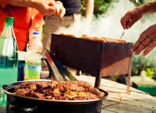 BBQ. Closeup of barbecue grilling picnic in backyard outdoor Stock Image