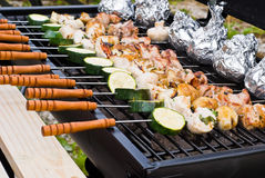 BBQ Cooking. Sticks on a grate royalty free stock images