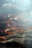 Bbq cooking fish. Photograph of bbq cooking fish seafood Stock Image
