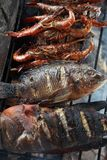 Bbq cooking fish. Photograph of bbq cooking fish seafood Stock Photos