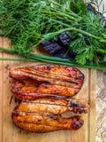BBQ de saumons de Coho avec des herbes image libre de droits