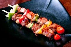 Bbq on dish. Pork bbq grill on dish Stock Photo