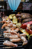 BBQ for everyone. Nice seafood on a BBQ grill. Summer is so great Stock Photo