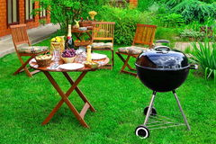 BBQ Family Party Scene In Decorative Garden On The Backyard. Summer BBQ Family Party Scene In The Decorative Garden On The Backyard. Charcoal Grill Appliance Stock Photo