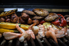 BBQ fest full summer on the grill. Seafood and vegetables on the grill for a nice BBQ Royalty Free Stock Image