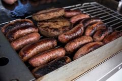 BBQ with fiery sausages Stock Photo