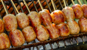 BBQ with fiery sausages on the grill background. Royalty Free Stock Photos