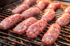 BBQ with fiery sausages on the grill Royalty Free Stock Images