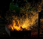 BBQ fire with sparks Royalty Free Stock Photography