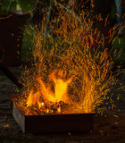 BBQ fire with sparks Stock Photography