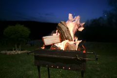BBQ fire wood burning in the night in countryside Royalty Free Stock Photography