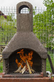 BBQ with fire wood. Preparing BBQ with fire wood burning inside Royalty Free Stock Photos