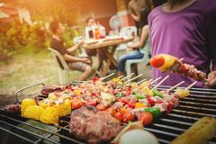 BBQ food party summer grilling meat. BBQ food party summer grilling meat in the afternoon of weekend happy party of asian people family stock images