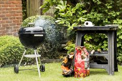 BBQ. Garden BBQ grill with lid on royalty free stock photos