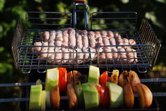 BBQ. Greeled meat and vegetables Stock Photos