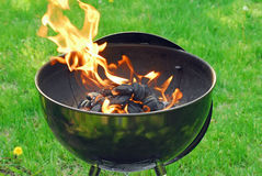 BBQ grill. Bar-B-Que grill with flames from charcoal stock image