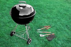 BBQ Grill Appliance On The Lawn With Tools And Glove Stock Photos