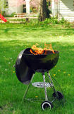 BBQ grill in backyard Royalty Free Stock Photo