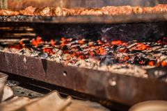 BBQ grill. With hot coal and delicious meat burgers roasting Stock Image