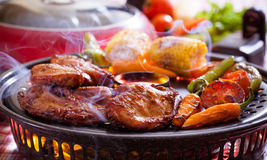 BBQ Grill. Chicken barbecue on a grilling pan stock images