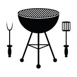 BBQ grill and cutlery Royalty Free Stock Photography