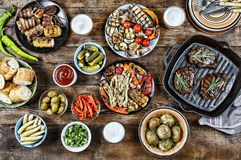 BBQ, grill, Dinner table, meat grill, new potatoes, salads, light beer stock photography